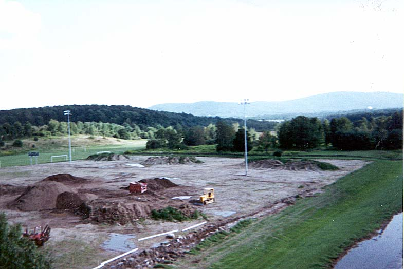 A photo of the construction area showing extensive work in the floodplain.